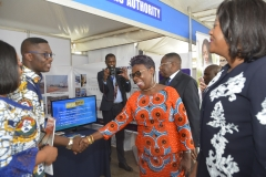 The CEO of GSA, Ms Benonita Bismarck interacting with a staff at the GSA's trade fair stand